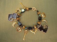 Halloween Charm Bracelet Black and Gold Cat by AllMyLoveofCrafts, $14.00