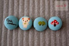 Fabric covered button- Petit Cochon set. $5.00, via Etsy.