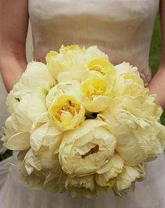 Yellow peonies with blue irises and some twigs and greenery is EXACTLY what I want my flower arrangments to consist of maybe throw in baby's breath or small white roses?