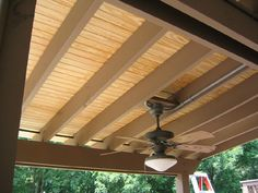 The patio ceiling has a natural wood finish.  The roof fasteners do not penetrate  the ceiling, making the patio area more appealing.