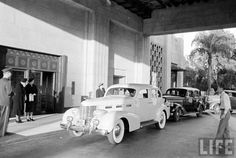 """From Life magazine, we have a glimpse into the good life in LA in 1938. The Bullocks Wilshire department store was the first to cater to the """"carriage trade"""" (i.e. not walk-past-the-front-door shoppers) by building the main entrance at the rear. Shoppers left their car under the porte cochere where valets would park it for them. And as the customers bought various goodies, their purchases would be sent directly to the car so that the customers wouldn't be lumbered with enormous packages."""