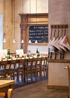 Simple, stunning, sublime. I love the restrained palette, textures and materials in this dining space. The wooden accents work perfectly against the exposed walls.  Le Pain Quotidien | Spain