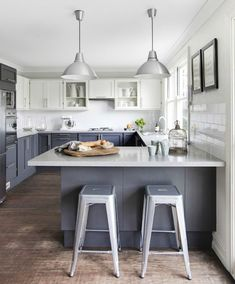GRAY BLUE KITCHEN CABINETS: clean and #modern kitchen design with #Tolix stools + pendant #lighting