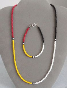 """Made by Rita, Mi'kmaq Indian of the Gesgapegiag Mi'kmaq tribe. 4 Colors/Directions Beaded Necklace, Bracelet Set. Necklace & Bracelet . Bracelet is 7 1/2"""". Necklace Length is 20"""". Made with high quality nylon coated beading wire. 
