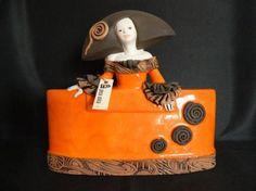 menina 05 (naranja)  arcilla,loza,esmaltes modelado,coccion