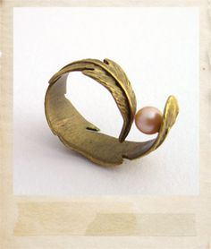 Bird feather ring by Hitomi SASAKI, Japan