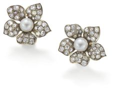 A pair of antique diamond and cultured pearl ear clips  Each designed as a five petal flower set throughout with old brilliant- and circular...