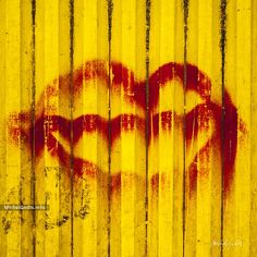 Graffiti of red lips on the yellow metallic surface of a construction container. Signed or unsigned print for art collectors and for a powerful impact in a grunge or industrial wall decor.