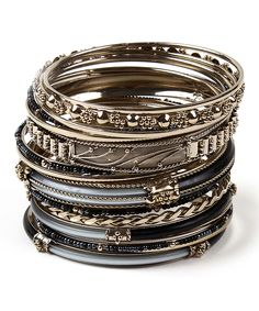Mixed textures and rustic hues lend elemental appeal to this bangle set. Stack one or all of them for various styles.Includes 18 banglesStacked: 2'' WSilvertone-plated brass / resinImported