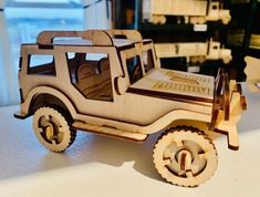Amish Wood Model Kit Jeep Delight a young mind with this build it yourself model kit! Includes 50 pieces made of solid birch wood. Airplane and tractor model kits also available. #woodtoys