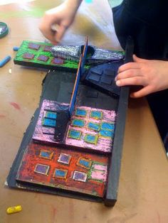 An amazing relief sculpture lesson using cardboard and wood scraps or any other junk laying around the art room!