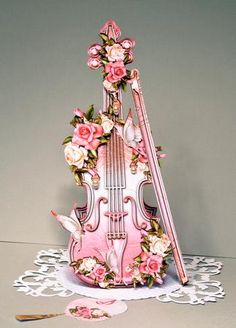 Vintage Soft Rose Violin on Craftsuprint designed by Atlic Snezana - made by Kristina Norbat - Printed on 250gsm card cutout all elements and assembled I added extra strip of card behind insert to give extra strength I added my decoupage and tiny pearls to complete this stunning design. - Now available for download!