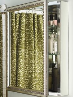 Add a decorative silver frame to a medicine cabinet mirror to add a touch of glamour and interest