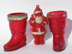Vintage Christmas Santa & boots candy containers. The boots originally had white painted at the top. The Santa was an ornament and held no candy. Mother used these in the 50's as part of the decorations around the house.