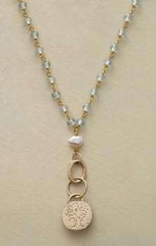This aquamarine and tree pendant necklace personifies unique, artisan crafted jewelry.