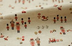 Kokka, Pink Toy Soldiers on Waffle Linen-Colored Cotton, U1950. $7.00, via Etsy.