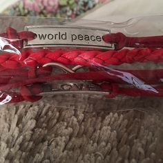 World peace, love, infinity red leather bracelet New in package. Popular leather bracelet. World Peace, Infinity, love. Jewelry Bracelets