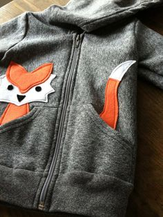 Inspiration :: Children's Fox Hoodie -- take a plain sweater and add a felt animal; head sticking out of one pocket, tail out of the other. Do I have to be a child to wear this?