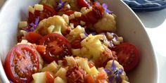 Cauliflower salad with tomato vinaigrette and cheddar cheese