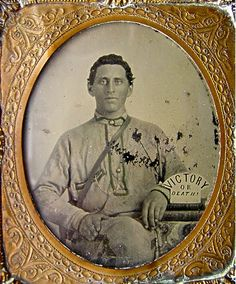Sixth Plate Ambrotype of Corporal Silas Shirley Company H, 16th Mississippi Infantry.  He wears a 3-button battle shirt.