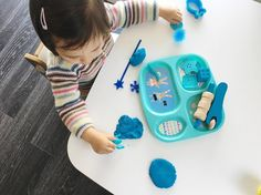 Blue play dough afternoon - she's obsessed with blue so this blue themed play dough tray was a hit. I used to hate 'junk toys' but now i know they can be used for other purposes. She was engaged stamping on the play dough with different shapes and textures, 'baking' a birthday cake, the options are endless.
