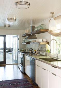 reclaimed wood shelving + white paneling + hardwood flooring by Jennifer Worts
