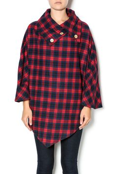 Flannel pullover touts a fold over, buttoned collar, and a poncho-inspired silhouette.