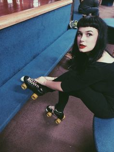 All in black roller skate girl with Betty Page style fringe haircut #vintage #pinup