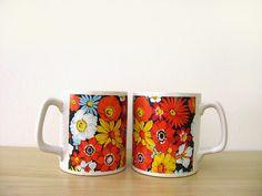Floral coffee mugs.