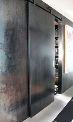 These Steel Sliding Doors are made from steel skinned over a Euro-ply core w. These Steel Sliding Doors are made from steel skinned over a Euro-ply core with Tig welded seams. Sliding Door Design, Sliding Door Systems, Sliding Doors, Industrial Door, Industrial Shelving, Industrial Lighting, Industrial Bedroom, Industrial Office, Industrial Farmhouse