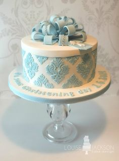 Hatbox style christening cake with damask print