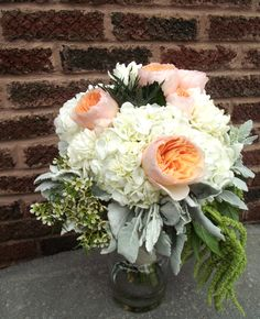 white, peach and dusty green bridal bouquet. David Austin peach garden roses seeded willow euculyptus white hydrangea  silvery dusty miller green hanging amaranthus fluffy white football mums