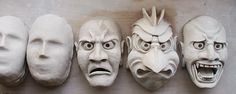"My newest set of 3 Japanese themed masks on my work bench. Bone dry and ready for bisque firing.  All 3 started from the generic mask ""blank..."