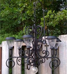 Description: Up-cycle an old lighting fixture to create a one-of-a-kind garden chandelier with spray paint & solar lights. Check out Lowe's Idea Exchange today to see more inspiring projects.
