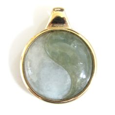 Stunning 14k gold bezel set carved jade Yin Yang symbol pendant. A great deal of Chinese philosophy stems from the concept of yin and yang - it depicts opposites interacting and is supposedly the seed of all things; representing perfect balance. Made from a combination of two types of jade, icy and sage green in color, the stones in this piece are carved and fused to form the complete symbol. Wear this pendant as a beautiful daily reminder of this philosophy.