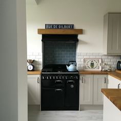 Read all about my kitchen makeover at www.overatkates.com Grey kitchen / Rangemaster / Country Kitchen / Open plan kitchen