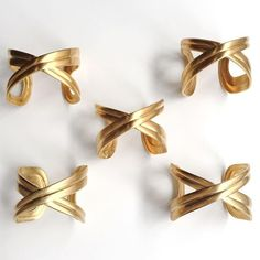 Vintage criss cross gold cuff bracelets. #jannaconner