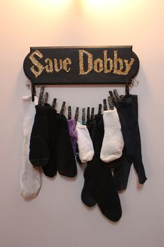 "Best way ever to keep track of lone socks! I think I'd write ""free dobby"" instead."