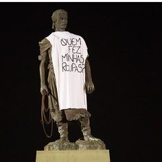 """Dress a statue, take a photo and share! """"As Fashion Revolution Week is dawns in Brasil, the city of Porto Alegre's iconic statues asked an important question: """"Quem fez minhas roupas?"""" (Who made my clothes?) ."""""""
