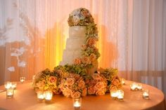 Beautiful cascading floral decor surrounded by bridesmaids bouquets