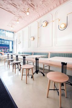 low wood stools and dining banquette with green velvet upholstery inside true true pizza parlor. Bar Restaurant Design, Cafe Restaurant, Luxury Restaurant, Architecture Restaurant, Interior Architecture, Commercial Design, Commercial Interiors, Design Café, Design Color