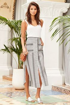 The Love Sweet Love Grey Striped Midi Skirt is here to brighten your day! Grey and white striped woven cotton shapes a high, banded waist (with elastic at back for fit) atop the midi skirt with rounded front pockets and full button placket. Rounded hem with side slits.