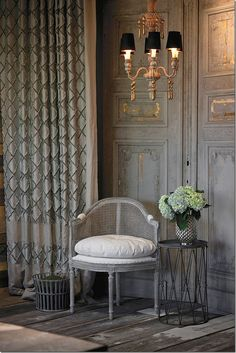This Aidan Gray chair has a gray chalk finish, with French nail heads & caned back.