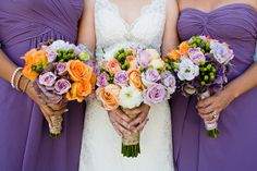 purple bridesmaids dresses, love the orange pops of color in the flowers!