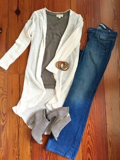 flare jeans outfit; early fall outfit; flare jeans with long cardigan