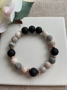 Essential Oil Diffuser Bracelet This gemstone stretch bracelet is simply gorgeous! Made with beautiful pink Zebra Jasper beads in a matte finish, Lava Stone beads for diffusing essential oils and accented with rose gold metal spacer beads. Pretty enough to wear alone, or mix it up with other bracelets to create your own unique bracelet stack. gift for her, gift for wife, gift for girlfriend, gift for mom