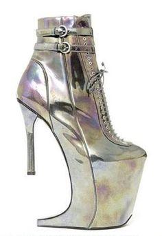 Google Afbeeldingen resultaat voor http://www.shoewawa.com/assets_c/2012/03/nina-ricci-boots-thumb-276x400-152855.jpg