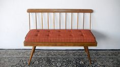 Astounding Vintage Bench Design Ideas Performing Natural Wood Grain Accentuate Frames With Simple Backrest On Black Traditional Motif Kilim Rug For Vintage Inspired Chairs Ideas. A vintage padded finish and solid wood construction highlight this bench. The bench has a vertical stripes style backrest with slanted cone legs without arm rests.