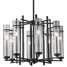 A fine balance between delicate clear glass and strong steel distinguishes the Feiss Ethan Chandelier. It features six or eight Clear glass shades arranged around a dark, industrial-looking steel frame. Outdoor Chandelier, Mini Chandelier, Modern Chandelier, Light Bulb Wattage, Iron Chandeliers, Hanging Pendants, Chandelier Lighting, Glass Shades, Clear Glass
