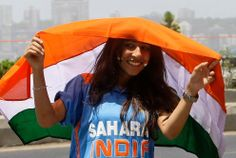 A supporter of India holds the national flag outside Wankhede stadium before the Cricket World Cup final match between India and Sri Lanka in Mumbai, India, Saturday, April 2, 2011. (AP Photo/Rajanish Kakade)